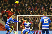Nottingham Forest defender Matt Mills makes a challenge in the air during the Sky Bet Championship match between Nottingham Forest and Queens Park Rangers at the City Ground, Nottingham, England on 26 January 2016. Photo by Aaron Lupton.