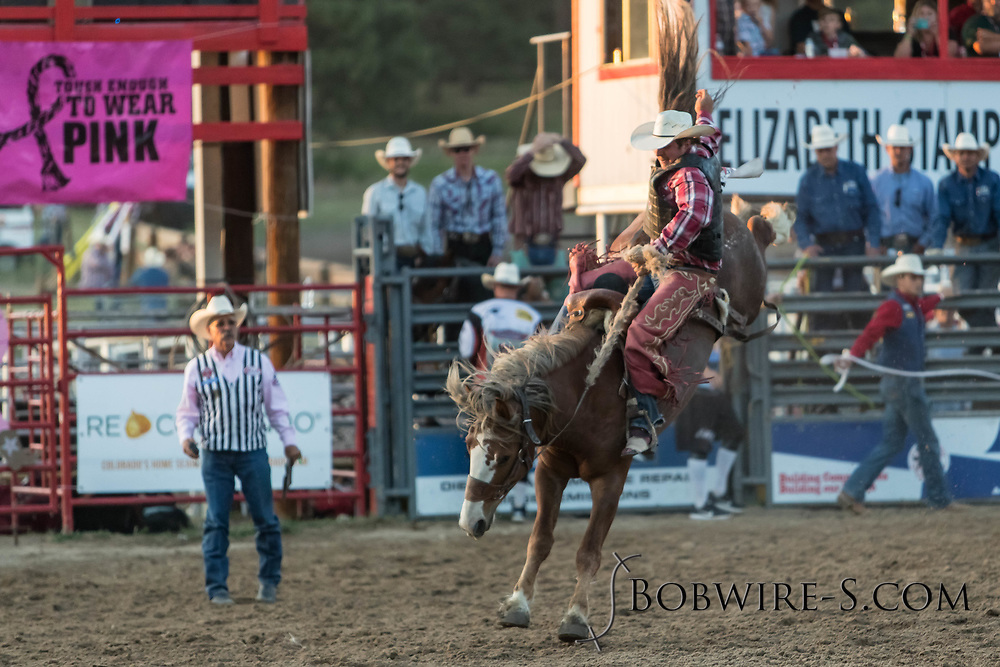Saddle bronc rider JW Meiers rides Summit Pro Rodeo's Moccasin Tracks in the second performance of the Elizabeth Stampede on Saturday, June 2, 2018.