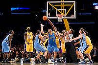 30 November 2006: The Los Angeles Lakers and Utah Jazz reach for the ball during a jump ball between the Lakers' Kobe Bryant and the Jazz' Carlos Boozer during the second half of the Lakers 132-102 victory over the Jazz at the STAPLES Center in Los Angeles, CA.<br />