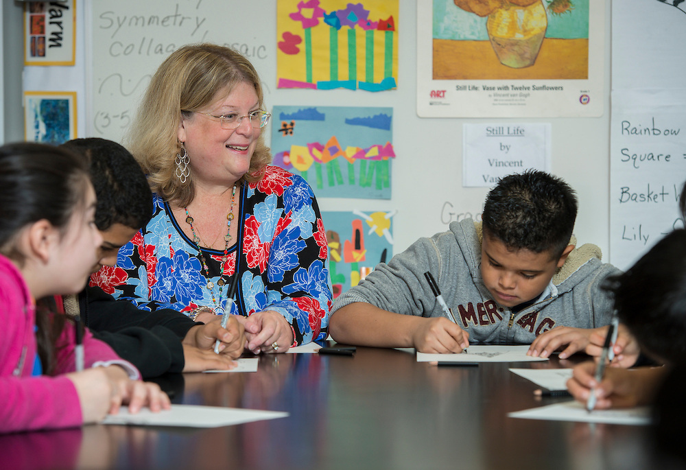 Rebecca Stewart works with her art students at Benavidas Elementary School, April 15, 2014.