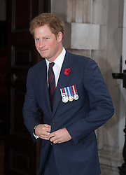 LONDON- UK - 29-OCT-2014: Prince Harry, attends the Service of Remembrance and Re-dedication for members of The Victoria Cross and George Cross Association at St. Martin-in-the-Fields, Trafalgar Square, London, <br /> Met by Insp Jim Beaton GC who was awarded the George Cross defending Princess Anne in an attack on the Mall in London.<br /> Photograph by Ian Jones