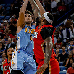 Apr 4, 2017; New Orleans, LA, USA; Denver Nuggets forward Danilo Gallinari (8) shoots over New Orleans Pelicans forward DeMarcus Cousins (0) during the second quarter of a game at the Smoothie King Center. Mandatory Credit: Derick E. Hingle-USA TODAY Sports