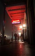 January 9, 2013, New Orleans LA, Tourists Decuater Street on a foggy night in the French Quarter.