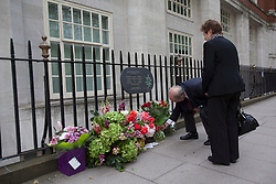 © licensed to London News Pictures. London, UK 07/07/2012. 7/7 victims being remembered as a family leaves flowers to the memorial in Tavistock Square on attack's 7th anniversary. Fifty-two people, as well as the four bombers, were killed in the London bombing attacks, and over 700 more were injured. Photo credit: Tolga Akmen/LNP
