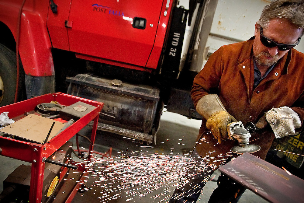 JEROME A. POLLOS/Press..Steve Pritchett, a mechanic with the City of Post Falls as well as a street maintenance worker, fabricates a slide to modify a dump truck Monday so it can be used in for paving work as well as other maintenance and construction needs for the city.
