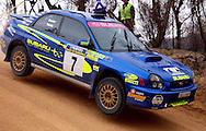 Cody Crocker & Greg Foletta over mine shaft.Subaru Impreza WRX.Motorsport-Rally/2003 Rally of Canberra .Canberra, ACT, Australia.Day 1 - 25th of April 2003.(C) Joel Strickland Photographics