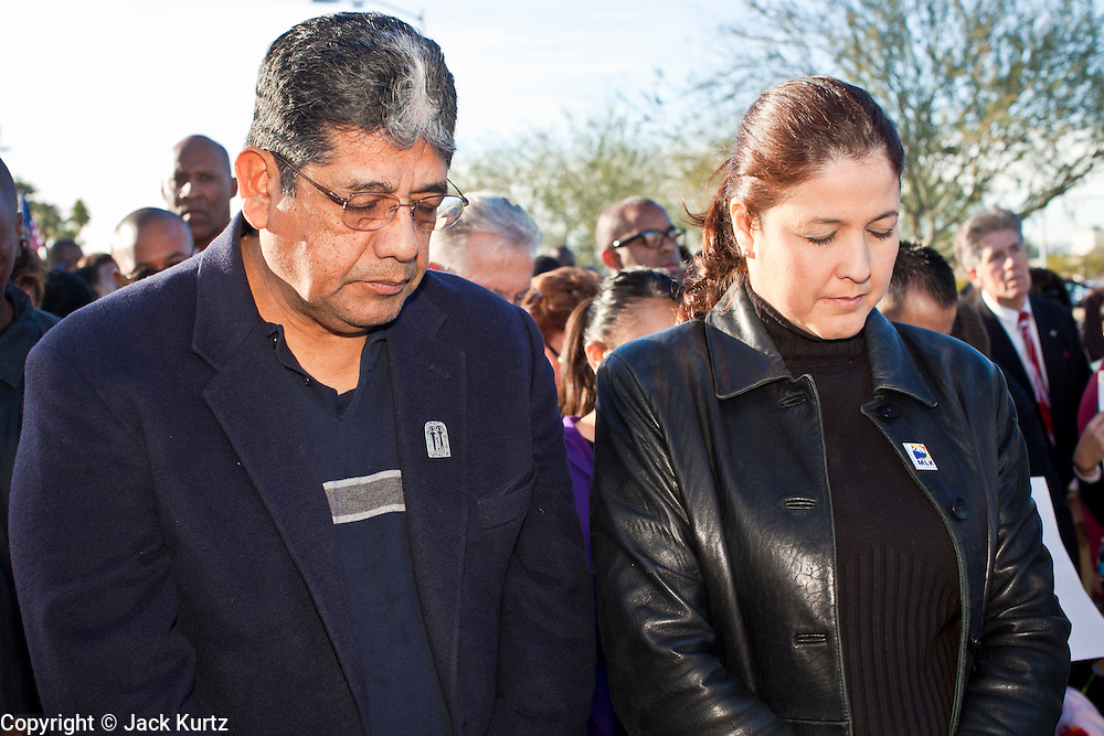 17 JANUARY 2011 - PHOENIX, AZ: BEN MIRANDA and his with CATHERINE MIRANDA bow their heads in prayer before the Martin Luther King march in Phoenix. Ben Miranda is a Democratic member of the Arizona Legislature. About 500 people participated the Martin Luther King Jr March through downtown Phoenix, Monday, Jan. 17. PHOTO BY JACK KURTZ