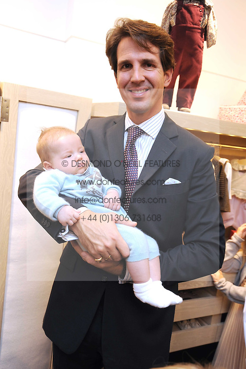 CROWN PRINCE PAVLOS OF GREECE with his son PRINCE ARISTIDE at a party to celebrate the opening of Pincess Marie-Chantal of Greece's store 'Marie-Chantal' 133A Sloane Street, London on 14th October 2008.