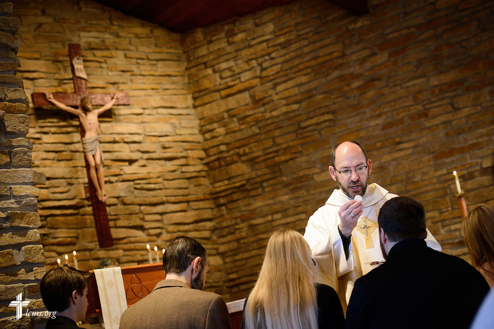 The Rev. Peter Bender, pastor of Peace Lutheran Church in Sussex, Wis., distributes the Sacrament during communion on Transfiguration Sunday, Feb. 7, 2016, at the church in Sussex. LCMS Communications/Erik M. Lunsford