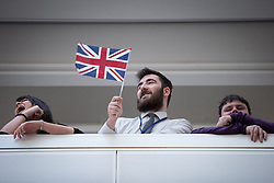 © Licensed to London News Pictures . 14/11/2013 . Manchester , UK . People wave from the balconies . Queen Elizabeth II and the Duke of Edinburgh visit the Coop building at 1 Angel Square , Manchester , this morning ( 14th November 2013 ) . Photo credit : Joel Goodman/LNP