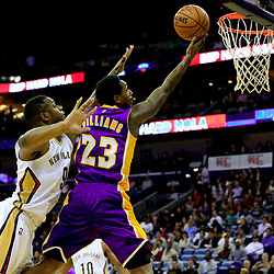 Nov 12, 2016; New Orleans, LA, USA;  Los Angeles Lakers guard Louis Williams (23) shoots over New Orleans Pelicans forward Terrence Jones (9) during the first half of a game at the Smoothie King Center. Mandatory Credit: Derick E. Hingle-USA TODAY Sports