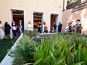 """Teresa Mavica, Director of the V-A-C Foundation (m., white shirt) is launching """"sudest 1401"""", a new project with Hamed Ahmadi (to her right) and his Venice based restaurant Orient Experience at their Venice headquarters Palazzo delle Zattere."""