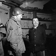 April 1945, Germany. Former Czec general found in a German Prison being interviewed by an American interpreter.