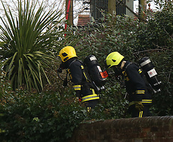 Southampton,Hampshire Monday 5th December 2016 A man has suffered serious burns to this arms following a house fire that broke out on the High Street in Bursledon this morning on Monday just after 7am.<br /> The alarm as raised by. passing dog walker who spotted flames in the window of the property after being alerted by his pet dog. Five fire crews from Hightown,Botley and St Mary&rsquo;s supported by an aerial ladder are dealing with the ongoing incident.  That is believed to have started in a workshop attached to the rear of the property. Shocked residents in the village have spoken of their upset one close to tears said the man has been the longest resident in the village I&rsquo;m gutted for him one of my friends is at this bedside they have had to put him to sleep and he is about to be taken Salisbury burns unit. I really hope he is going to be alright. He is a lovely man would do anything for anyone. <br /> Group Manager Tony Deacon from Hampshire Fire and Rescue service said that crews had to smash down the front door of the property to rescue a man who was trapped whilst other crews tackled a well-developed blaze at the rear of the property using the lance system. Crews pulled the man from the property who was treated at the seen by South Central ambulance service and then taken to Southampton general hospital Mr Deacon went on to say that fire had spread to the roof the property and crews where likely to remain on scene until at east 4pm today&copy;UKNIP