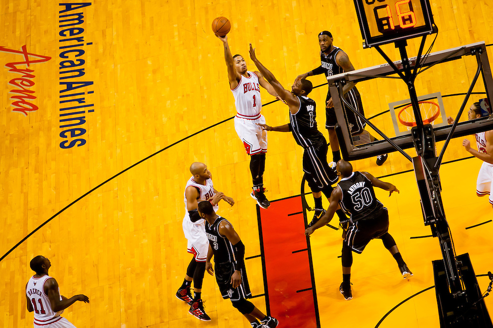 MIAMI, FL -- January 29, 2012 -- Chicago's Derrick Rose shoots over Miami's Chris Bosh during the Heat's 97-93 win over the Bulls at American Airlines Arena in Miami, Fla., on Sunday, January 29, 2012.  (Chip Litherland for ESPN the Magazine)