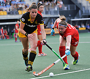 Den Bosch's Lidewij Welten  challenges with Monkstown's Laura Pinder during their opening game of the EHCC 2017 at Den Bosch HC, The Netherlands, 2nd June 2017