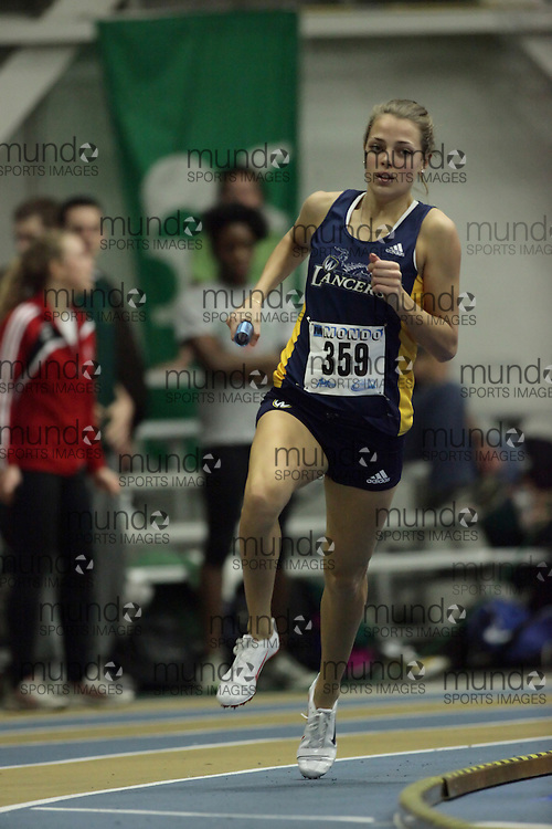 (Windsor, Ontario---12 March 2010) Melissa Bishop of University of Windsor Lancers   competes in the 4x800m final at the 2010 Canadian Interuniversity Sport Track and Field Championships at the St. Denis Center. Photograph copyright Geoff Robins/Mundo Sport Images. www.mundosportimages.com