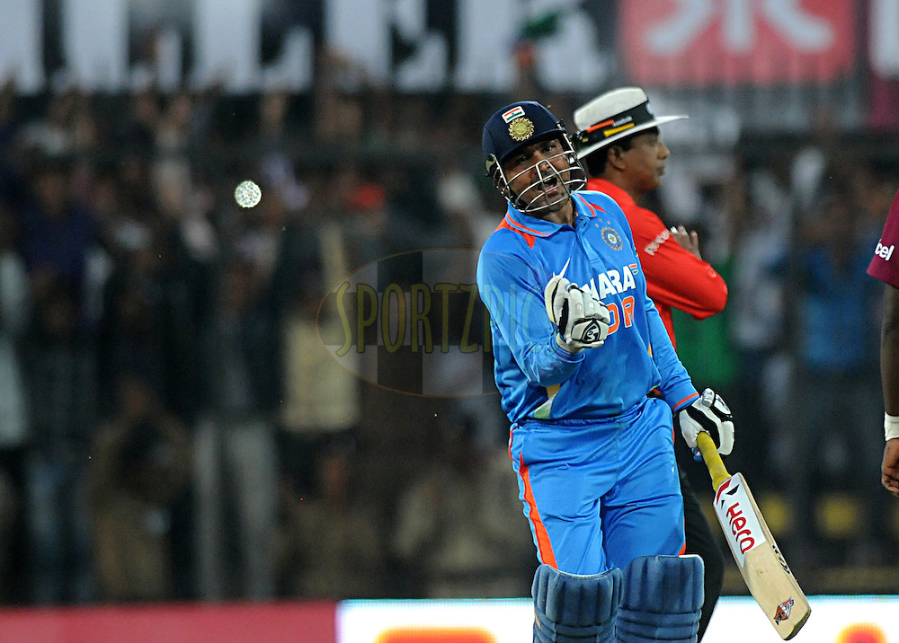 Virender Sehwag captain of India celebrate after scoring a  double century during the 4th ODI ( One Day International ) match between India and The West Indies held at The Holkar Cricket Stadium in Indore, India on the 8th December 2011..Photo by Pal Pillai/BCCI/SPORTZPICS