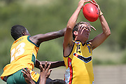POTCHEFSTROOM, SOUTH AFRICA - JANUARY 28, Jayden Gerrand (Sinagra, WA) of the Australian Boomerangs gets his face grabbed by Thabiso Phakedi (GP Blues) of the SA Lions during the AFL Game 1 match between the Flying Boomerangs and South African Lions under 18's at Mohadin Cricket Ground on January 28, 2013 in Potchefstroom, South Africa.Photo by Roger Sedres / Image SA