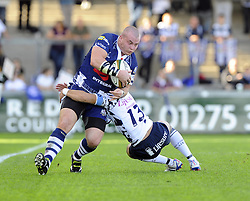 Bedford Blues' Sam Stanley  tackles Bristol Rugby's James Hall - Photo mandatory by-line: Joe Meredith/JMP - Tel: Mobile: 07966 386802 06/10/2013 - SPORT - FOOTBALL - RUGBY UNION - Memorial Stadium - Bristol - Bristol Rugby V Bedford Blues - The Championship