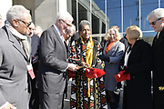 Photo &copy;Suzi Altman 12/9/17 Jackson,MS Front and center for the ribbon cutting at the new Civil Rights and History Museums in Mississippi is Myrlie Evers- Williams, widow of slain civil rights leader Medgar Evers. President Trump made private remarks during the grand opening of the Civil Rights and History Museums in Jackson Mississippi inside to a private crowd, before ribbon cutting.  Pictured at ribbon cutting ceremony, center,  Myrlie Evers, to her right Mrs. Bryant and MS. Governor Phil Bryant. Trump spoke to a small private group of civil rights icons, museums directors, and other elected officials including MS. Governor Bryant in the auditorium after his brief tour of the museum. Trump said &quot;the Civil Rights Museum is a tribute to our nation and to the State of Mississippi &quot; and he paid tribute to other leaders of the civil rights movement including James Meredith and Medgar Evers . Trumps appearance was controversial to many residents of the state of Mississippi and protests were scattered around the museums exterior.   Myrlie Evers- William widow of slain civil rights icon Medgar Evers attended the opening of the Mississippi Civiil Rights and History Museums. Evers spoke to the crowd outside after President Trump made private remarks inside to a closed audience of invited guests and press only. <br />  Right before the ribbon cutting ceremony outside on the podium Mrs Evers said &quot; These museums are priceless, going through the museum of my history I felt the bullets and the fears, but I also felt the hope.&quot; President Trump had a very short private tour of the Civil Rights Museum and did not mingle outside or stop to talk with any visitors to the new Civil Rights  museum. Photo&copy;SuziAltman