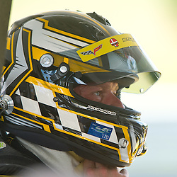 July 6, 2012 - Corvette Racing driver Jan Magnussen removes his helmet in the pits during the American Le Mans Northeast Grand Prix weekend at Lime Rock Park in Lakeville, Conn.