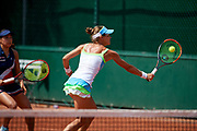 Paris, France - 2017 June 02: Alicja Rosolska from Poland plays a backhand while her women's double match second round during tennis Grand Slam tournament The French Open 2017 (also called Roland Garros) at Stade Roland Garros on June 02, 2017 in Paris, France.<br /> <br /> Mandatory credit:<br /> Photo by &copy; Adam Nurkiewicz<br /> <br /> Adam Nurkiewicz declares that he has no rights to the image of people at the photographs of his authorship.<br /> <br /> Picture also available in RAW (NEF) or TIFF format on special request.<br /> <br /> Any editorial, commercial or promotional use requires written permission from the author of image.
