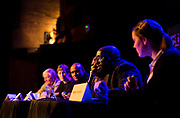 """Michael Ford, the """"Hip Hop Architect,"""" makes a point on the Capital Times panel discussion: """"How can Madison build more great neighborhoods?"""" at High Noon Saloon in Madison, Tuesday, November 7, 2017."""