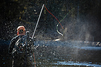 Alex Hudjohn. owner of H&H Outfitters fly fishing along the Wilson River, near Tillamook, Oregon.