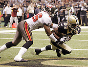NEW ORLEANS - OCTOBER 10:  Wide receiver Joe Horn #87 of the New Orleans Saints catches a 3 yard touchdown pass while covered by safety Dwight Smith #26 of the Tampa Bay Buccaneers at the Louisiana Superdome on October 10, 2004 in New Orleans, Louisiana. The Bucs defeated the Saints 20-17. ©Paul Anthony Spinelli *** Local Caption *** Joe Horn, Dwight Smith
