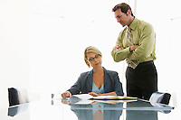 Business man and woman working in conference room