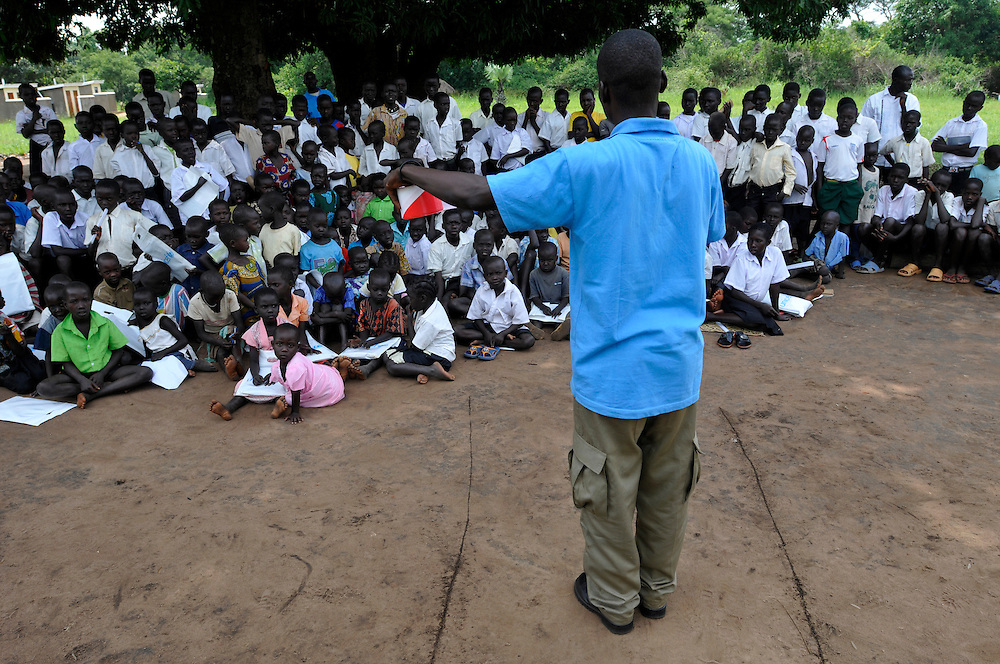 School children attend a mine risk education session conducted by a Community liaison team from Mines Advisory Group (MAG)..Morobo, South Sudan. 24/06/2011..Photo © J.B. Russell