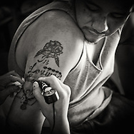 Republic of Lakotah.Pine Ridge Indian Reservation, South Dakota..Pine Ridge is the poorest Indian reservation in the United States. Almost have of it's residents live below the poverty line and unemployment is around 80%. ..Gang member gets a tattoo with the name of his baby who was stillborned. The infant mortality rate in the reservation is five times the national average.