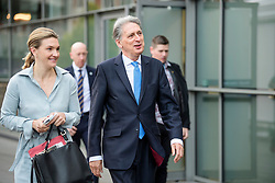 © Licensed to London News Pictures. 02/10/2017. Manchester, UK. Chancellor PHILIP HAMMOND and his special advisor POPPY TROWBRIDGE (left) are seen on the second day of the Conservative Party Conference. The four day event is expected to focus heavily on Brexit, with the British prime minister hoping to dampen rumours of a leadership challenge. Photo credit: Ben Cawthra/LNP