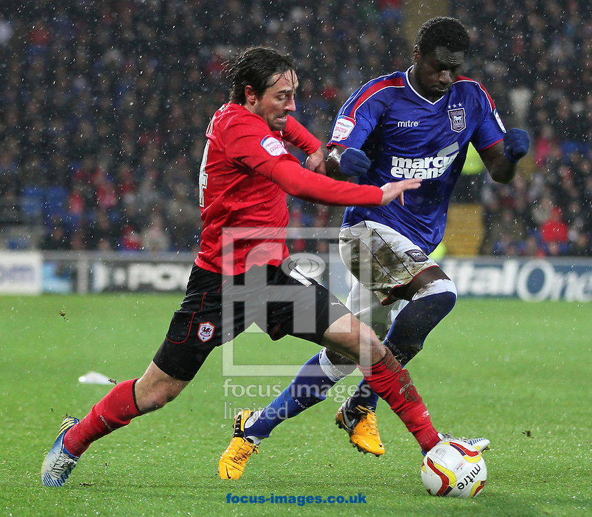 Picture by Mike  Griffiths/Focus Images Ltd +44 7766 223933.12/01/2013.Tommy Smith of Cardiff City and Guraine N'Daw of Ipswich Town during the npower Championship match at the Cardiff City Stadium, Cardiff.