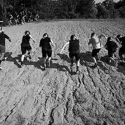 Kyle Green | The Roanoke Times<br /> August 03, 2009 - Northside High School players run sprints up a hill between drills during the first day of football practice.
