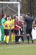 Referee Simon Parnaby has to step in the during the Women's FA Cup match between Watford Ladies FC and Brighton Ladies at the Broadwater Stadium, Berkhampstead, United Kingdom on 1 February 2015. Photo by Stuart Butcher.