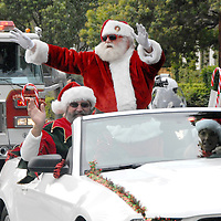 Santa Claus arrives at the Reed Park in a convertible during Santa Monica Firefighters' & Police Officers' Association Eighteenth  annual 'Candy Cane Drive' on Saturday, December 4, 2010.