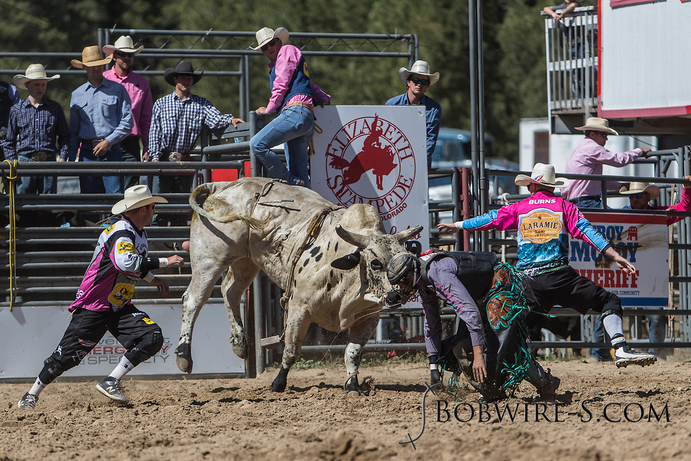 Bullfighters Cade Burns (right) and Nate Jestes rescue Cordell Curtis from Summit Pro Rodeo's 288 Gladiator in the first performance of the Elizabeth Stampede on Saturday, June 2, 2018.