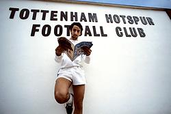 Tottenham Hotspur's Osvaldo Ardiles reads a copy of Onze at White Hart Lane