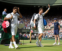 LONDON, ENGLAND - Wednesday, June 30, 2010: A victorious Tomas Berdych (CZE) celebrates as Roger Federer (SUI) looks dejected as they walk off Centre Court the Gentlemen's Singles Quarter-Final on day nine of the Wimbledon Lawn Tennis Championships at the All England Lawn Tennis and Croquet Club. (Pic by David Rawcliffe/Propaganda)