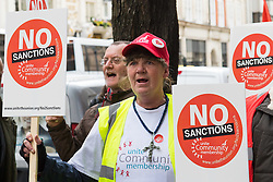 Department of Work and Pensions, Westminster, London, March 9th 2016. As part of a nationwide protest outside job centres a few dozen protesters dgather outside the Department for Work and Pensions to protest benefits sanctions agains disabled and sick people who infringe DWP rules on searching for jobs or missing job centre appointments, plunging many into poverty, with some eventually committing suicide. &copy;Paul Davey<br /> FOR LICENCING CONTACT: Paul Davey +44 (0) 7966 016 296 paul@pauldaveycreative.co.uk