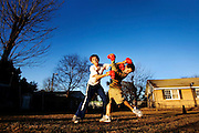 "Raymond Jolly watched his son and friends box at a corner field on Olympia Drive owned by the Jaco family. ""This is the same Olympia I had when I was going to school over there,"" he said. ""We played ball all the time around here."" Jolly thinks the community would flourish if there was a school for the area's kids. ""We need Olympia School back the way it was,"" he said."