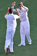 "Alastair Cook gets some high fives after catching Peter Siddle in the slips late on Day 1 of the 1st Test in the 2013-14 Ashes Cricket Series between Australia and England at the GABBA (Brisbane, Australia) from Thursday 21st November 2013<br /> <br /> Conditions of Use : NO AGENTS ~ This image is subject to copyright and use conditions stipulated by Cricket Australia.  This image is intended for Editorial use only (news or commentary, print or electronic) - Required Image Credit : ""Steven Hight - AURA Images"""