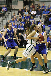 16 February 2013:  Emily Beoletto crashes into Brittney Gallivan during an NCAA women's division 3 basketball game between the Millikin Big Blue and the Illinois Wesleyan Titans in Shirk Center, Bloomington IL