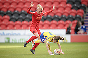 Christie Murray (Doncaster Rovers Belles) is caught by Sophie Ingle (Liverpool Ladies FC) during the FA Women's Super League match between Doncaster Rovers Belles and Liverpool Ladies at the Keepmoat Stadium, Doncaster, England on 9 October 2016. Photo by Mark P Doherty.