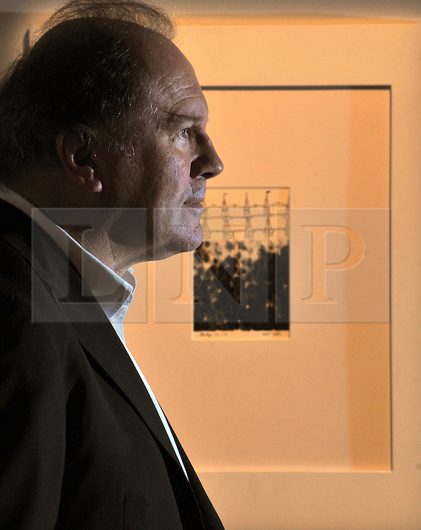 © Licensed to London News Pictures. 11/11/2011. London, UK. William Boyd photographed in front of the work.  Nat Tate's (1928 - 1960) Bridge no 114. First work to be offered for sale by fictional painter Nat Tate. Estimated to fetch 3,000 - 5.000 GBP. Nat Tate is a fictional artist created by bestselling British Author William Boyd and was part of a celebrated hoax in 1998.   Sotheby's preview of Modern and Post-War British Art which will offered for sale at auction on 15th November 2011. Photo credit : Stephen Simpson/LNP