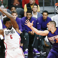 31 October 2016: Los Angeles Clippers center DeAndre Jordan (6) grabs a rebound over Phoenix Suns center Alex Len (21) during the Los Angeles Clippers XX-YY victory over the Phoenix Suns, at the Staples Center, Los Angeles, California, USA.