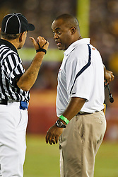 September 11, 2010; Los Angeles, CA, USA;  Virginia Cavaliers head coach Mike London argues a call with an official against the Southern California Trojans during the fourth quarter at the Los Angeles Memorial Coliseum. USC defeated Virginia 17-14.