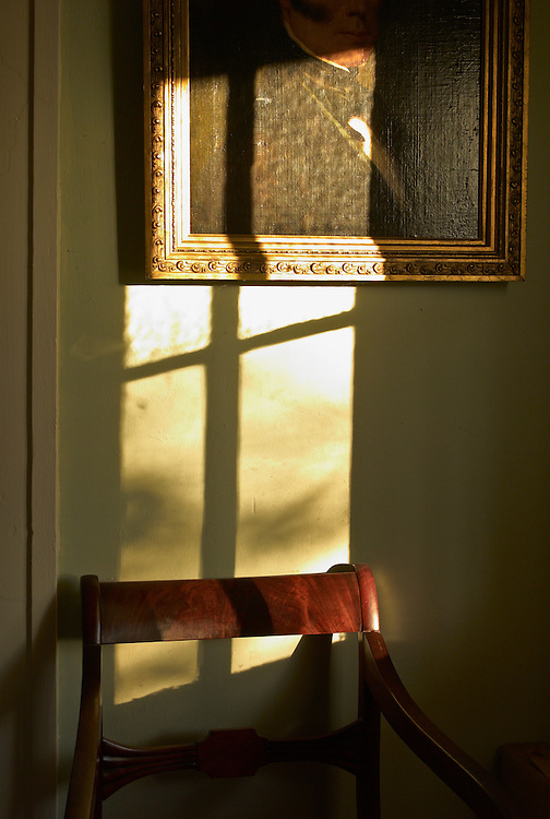 Antique painting and chair in window light
